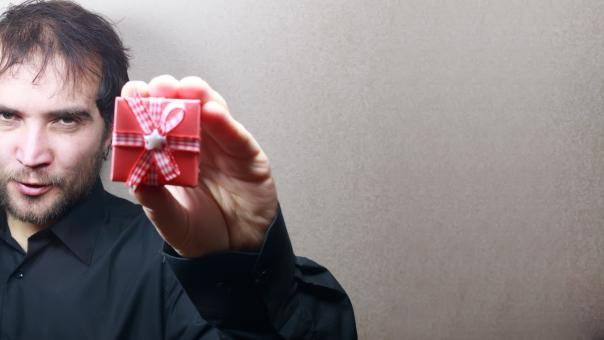 Free Stock Photo of young man holding a gift