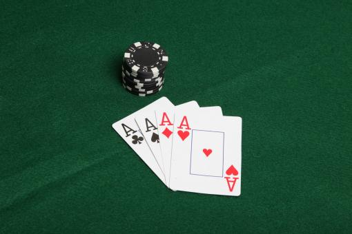 Free Stock Photo of Stack of black poker chips with four ace