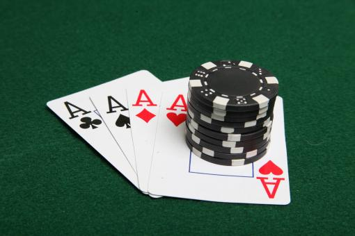 Free Stock Photo of Stack of black poker chips on four aces