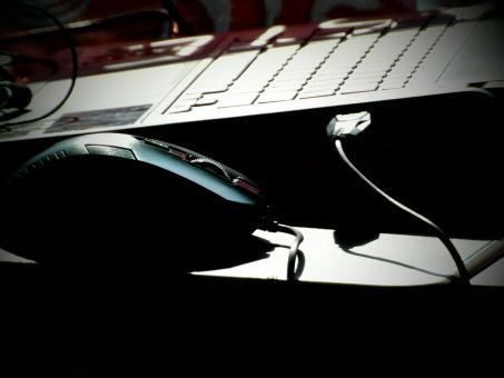 Free Stock Photo of Laptop and Mouse in Shadows