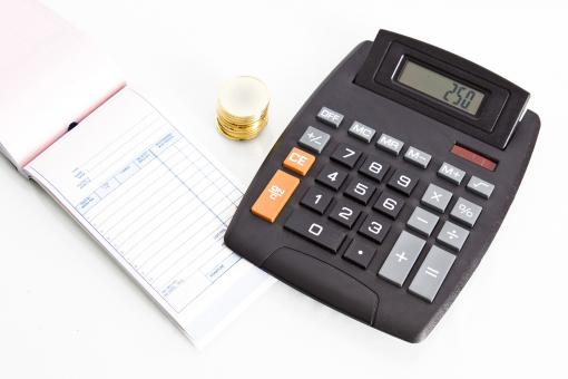 Free Stock Photo of Receipt book with calculator and coins