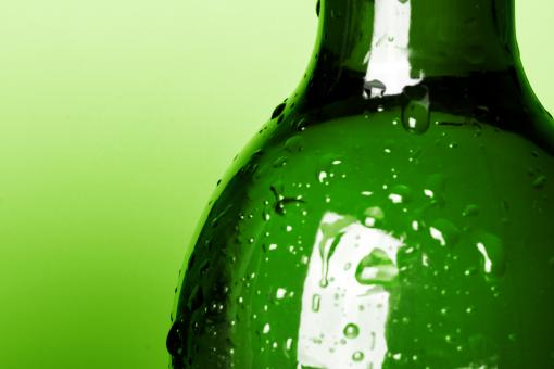 Free Stock Photo of Bottle with water drops - Green Background