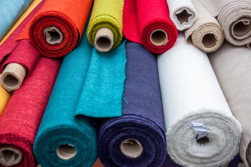 Free Stock Photo of Colorful fabric rolls