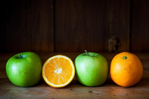 Free Stock Photo of Apple and orange fruit on brown wood