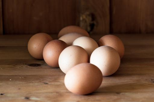 Free Stock Photo of Eggs on wood background