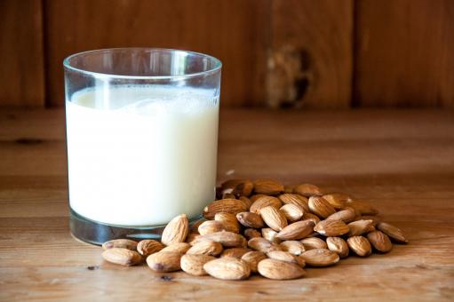 Free Stock Photo of Almond milk with almonds on wood