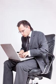 Free Stock Photo of Businessman using computer