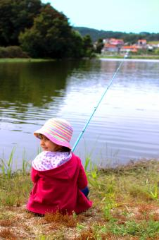 Free Stock Photo of Little girl fishing and smiling