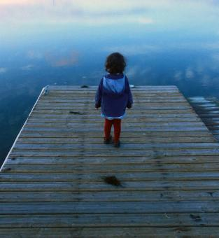 Free Stock Photo of Child looking out on the pier