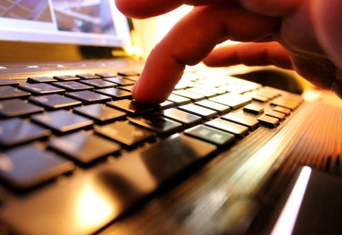 Free Stock Photo of Hands typing on laptop keyboard
