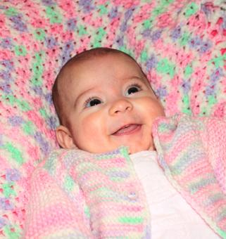 Free Stock Photo of Happy baby lying on a blanket