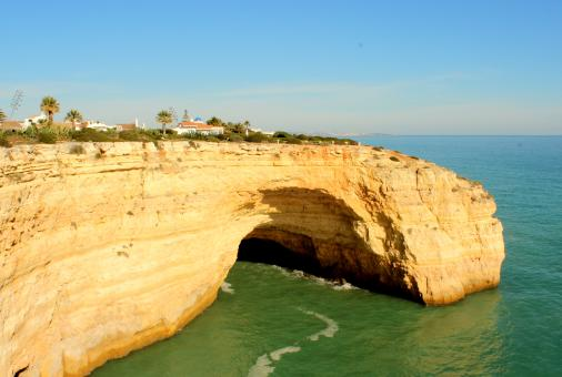 Free Stock Photo of Houses atop a huge cliff in Algarve