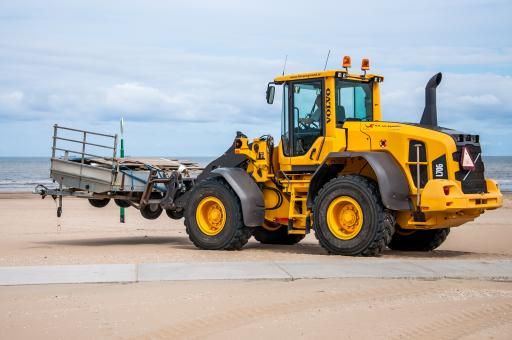Free Stock Photo of Bulldozer tractor working on a beach