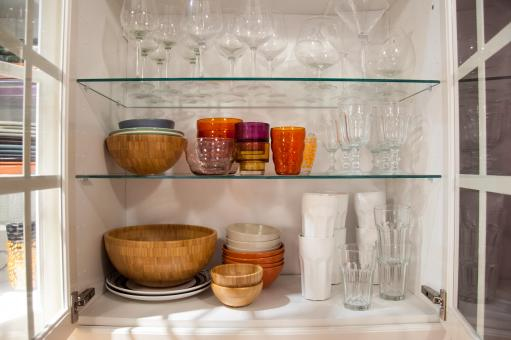Free Stock Photo of Opened cupboard with kitchenware inside