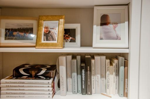 Free Stock Photo of Bookshelves with books and photo frames