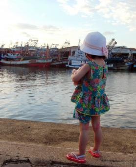 Free Stock Photo of Girl Looking at Fishing Boats