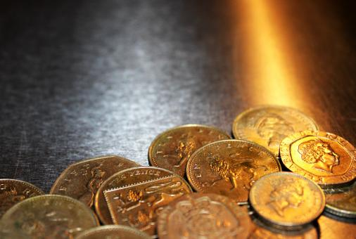 Free Stock Photo of British pound coins on metal background