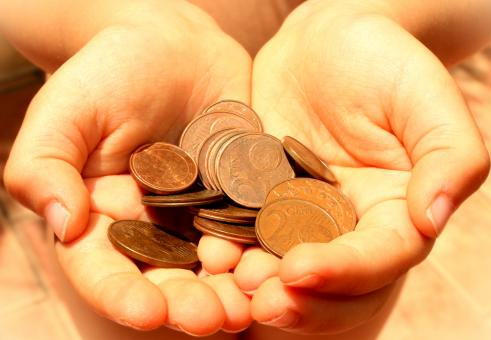Free Stock Photo of Hands showing euro coins
