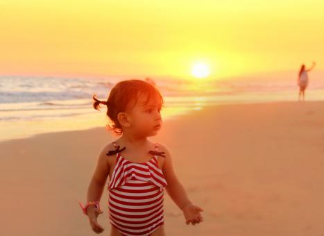 Free Stock Photo of Sweet little girl on the beach at sunset
