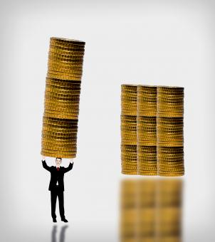 Free Stock Photo of Businessman carrying a gold coin stack
