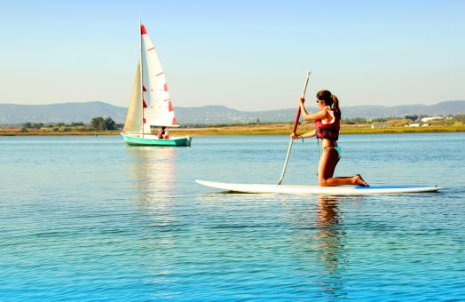 Free Stock Photo of Woman practicing stand-up paddle