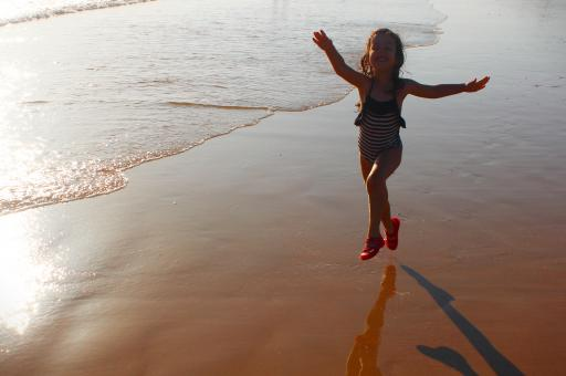 Free Stock Photo of Happy girl jumping on the beach at dawn