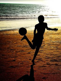 Free Stock Photo of Silhouette of a boy playing soccer