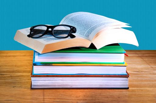 Free Stock Photo of Stack of books with a pair of eyeglasses
