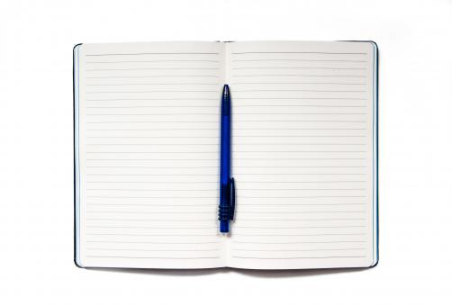 Free Stock Photo of Notebook with pen isolated on white