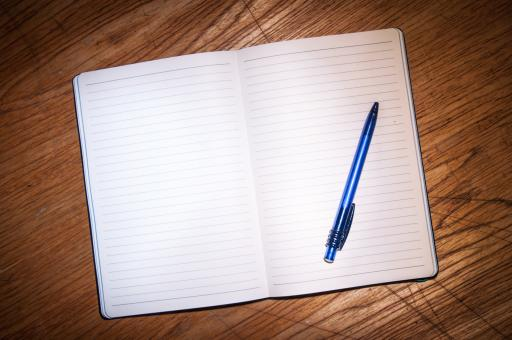 Free Stock Photo of Notebook with pen on table