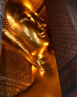 Free Stock Photo of Reclining Buddha gold statue face