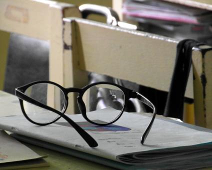 Free Stock Photo of Glasses on a School Desk