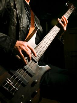 Free Stock Photo of Man playing electric bass