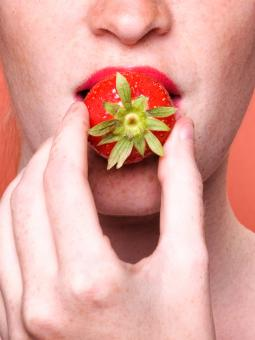 Free Stock Photo of Close up woman mouth eating strawberry