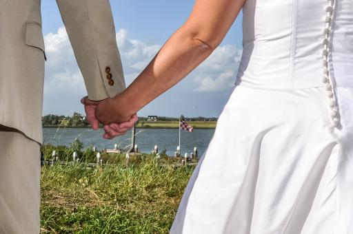 Free Stock Photo of Newlyweds holding hands