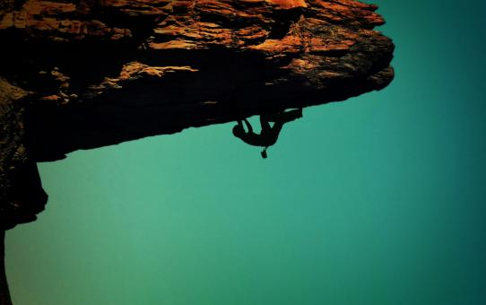 Free Stock Photo of Silhouette of a rock-climber