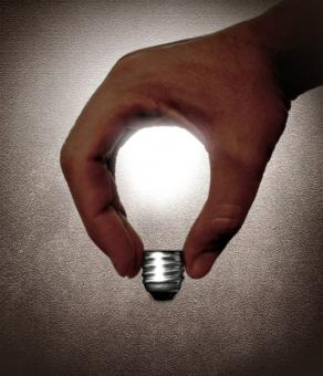 Free Stock Photo of Hand and lightbulb - Creativity and idea