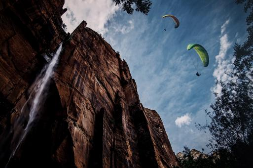 Free Stock Photo of Paragliding over a waterfall
