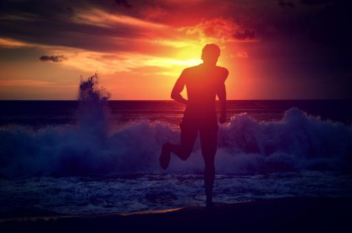 Free Stock Photo of Man running on the beach at sunset