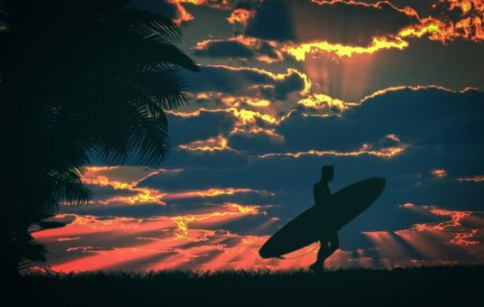 Free Stock Photo of Surfer and surfboard at sunset