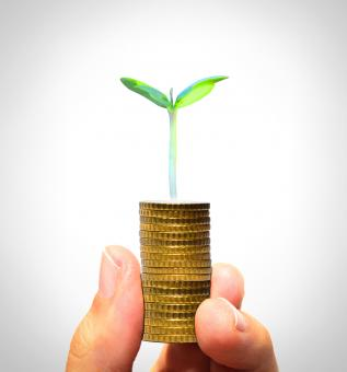 Free Stock Photo of Businessman holding plant sprouting from a handful of golden coins