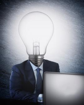 Free Stock Photo of Businessman with lightbulb head in front of the computer