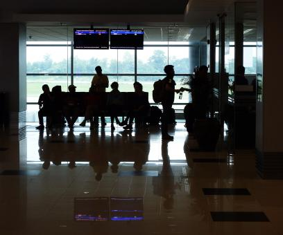Free Stock Photo of Passenger Silhouettes at Airport