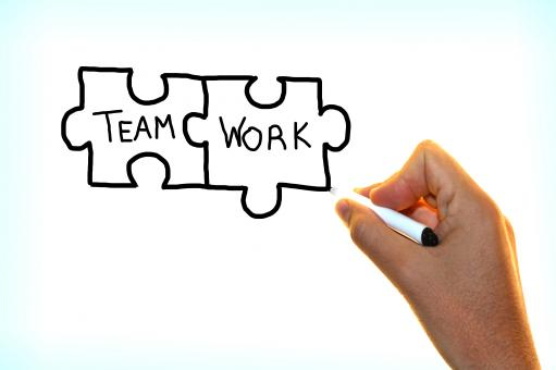 Free Stock Photo of Hand writing the words Team Work on virtual screen