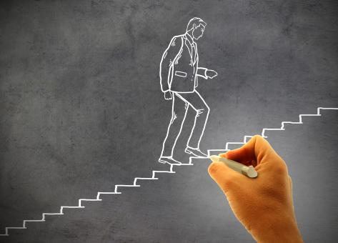 Free Stock Photo of Businessman climbing staircase - Concept of climbing the career ladder