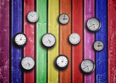 Free Stock Photo of Clocks on colorful wood background - Time concept