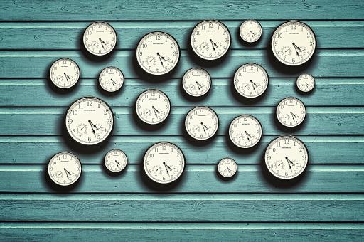 Free Stock Photo of Many clocks in a blue wooden background