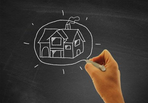 Free Stock Photo of Hand drawing a house on blackboard - Real estate and housing concept