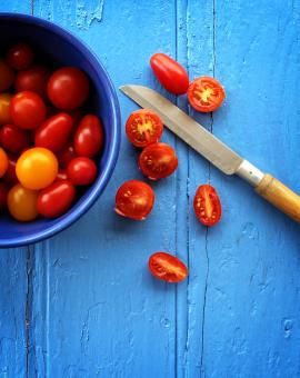 Free Stock Photo of  Freshly sliced organic cherry tomatoes on blue wooden background