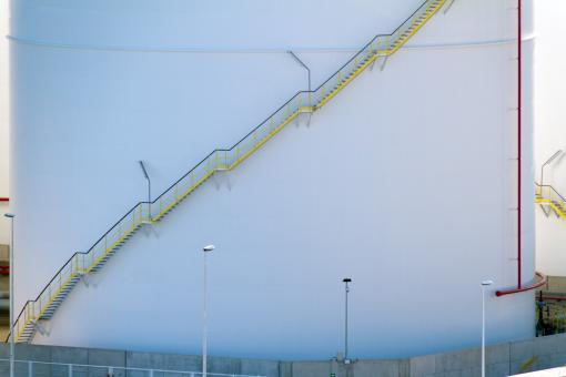 Free Stock Photo of Yellow stairs on a white storage tank